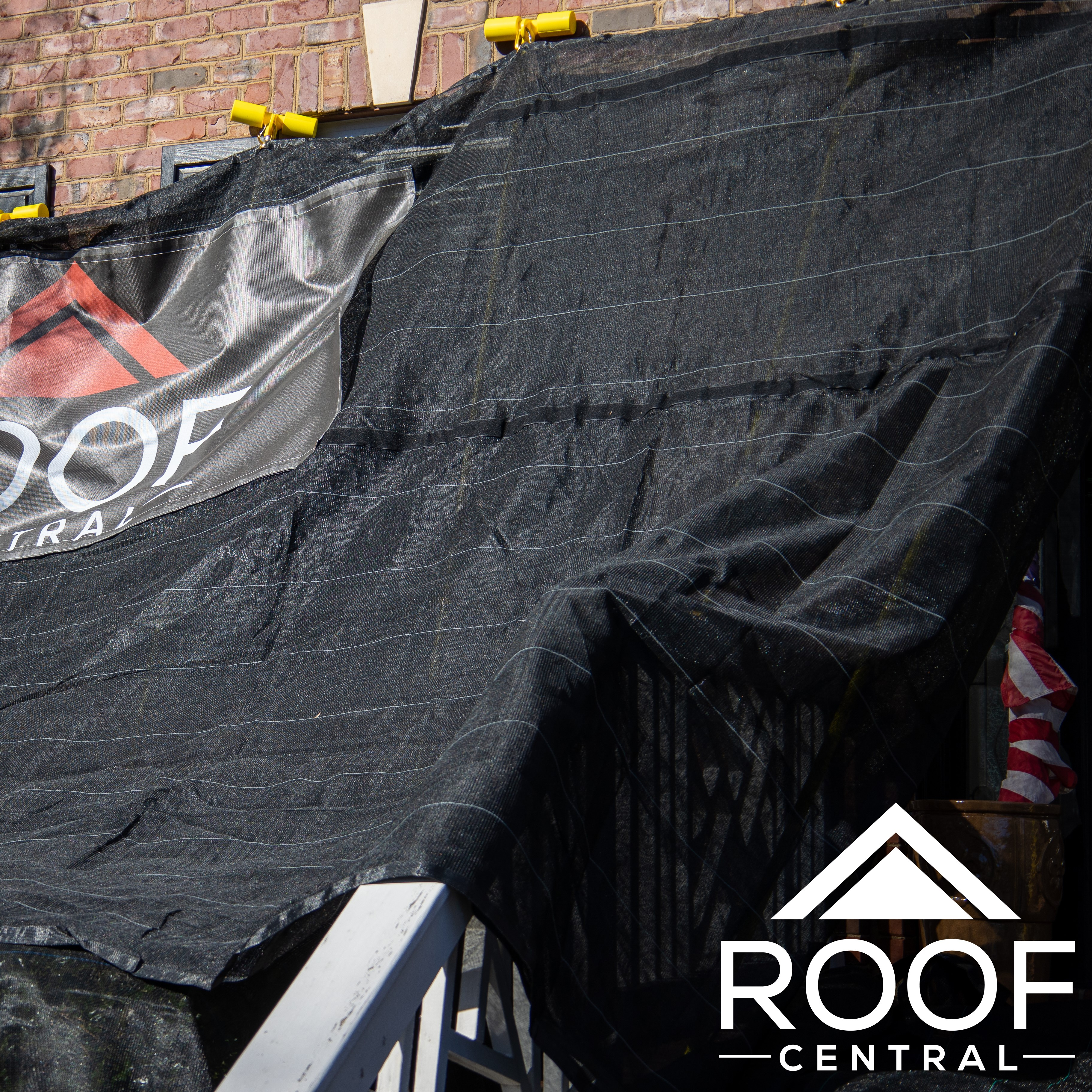 A tarp placed on a home to protect it.