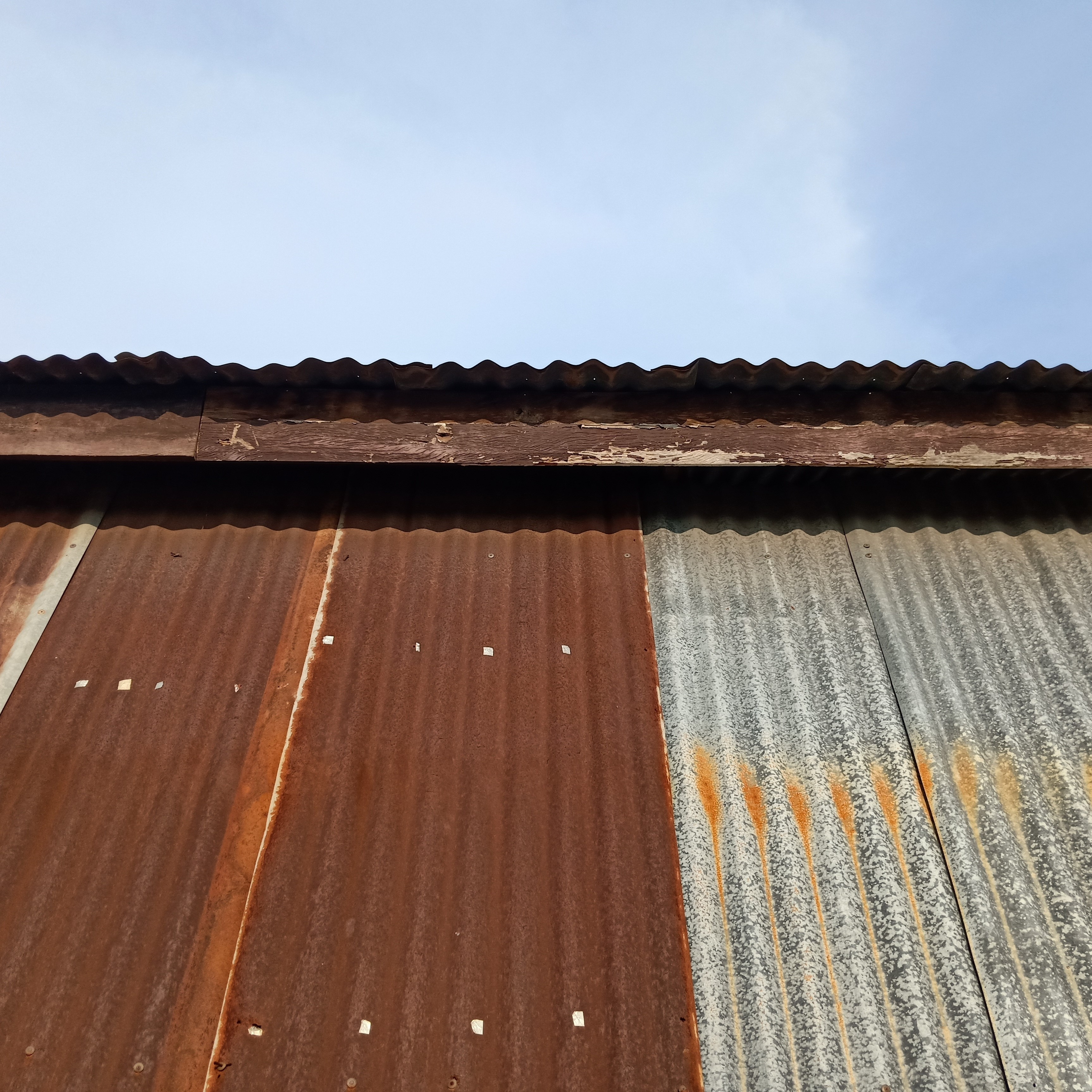 A rusty metal roof that may be in need of a coating.