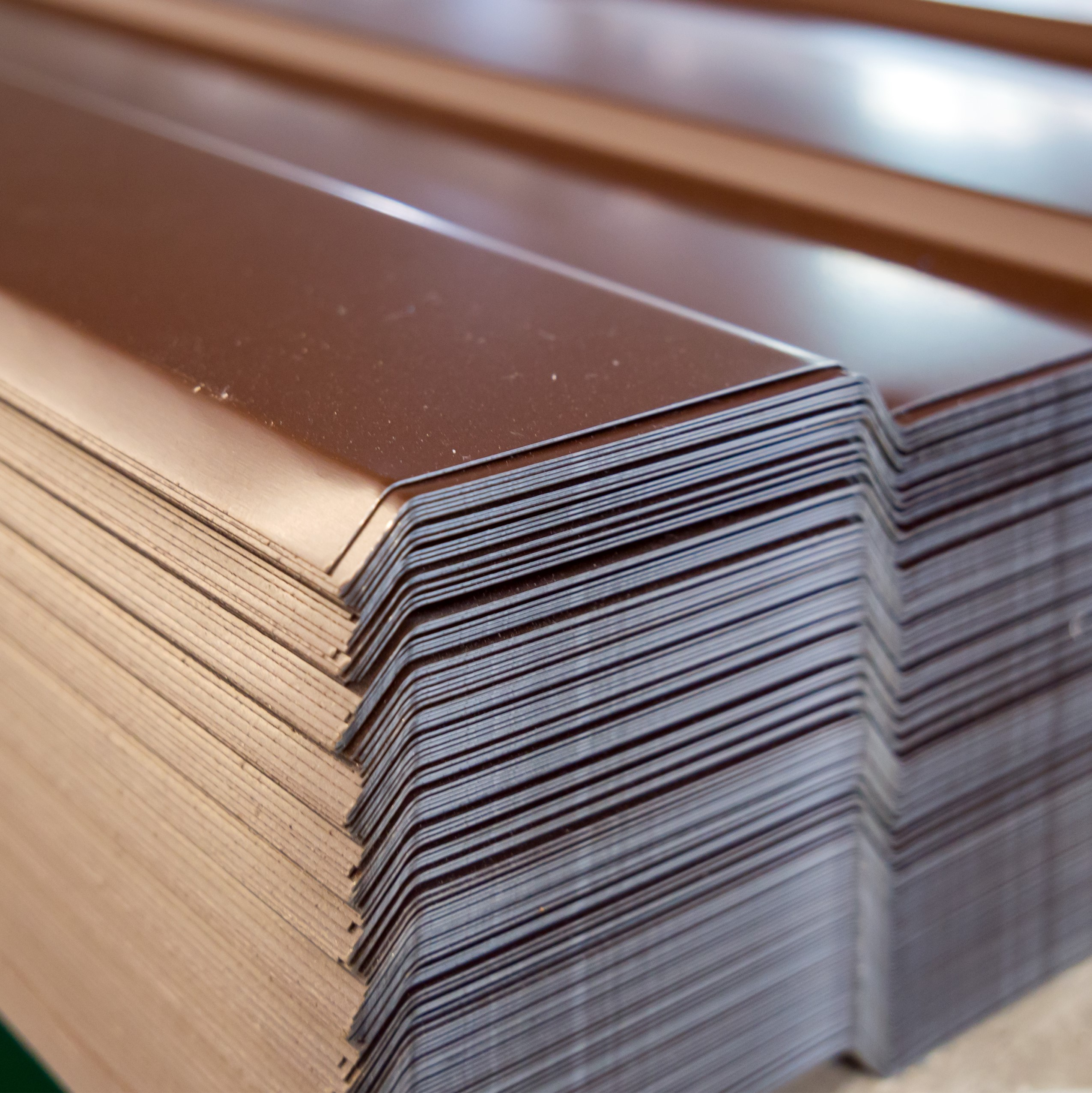 A type of metal roofing, stacked up and ready to install.