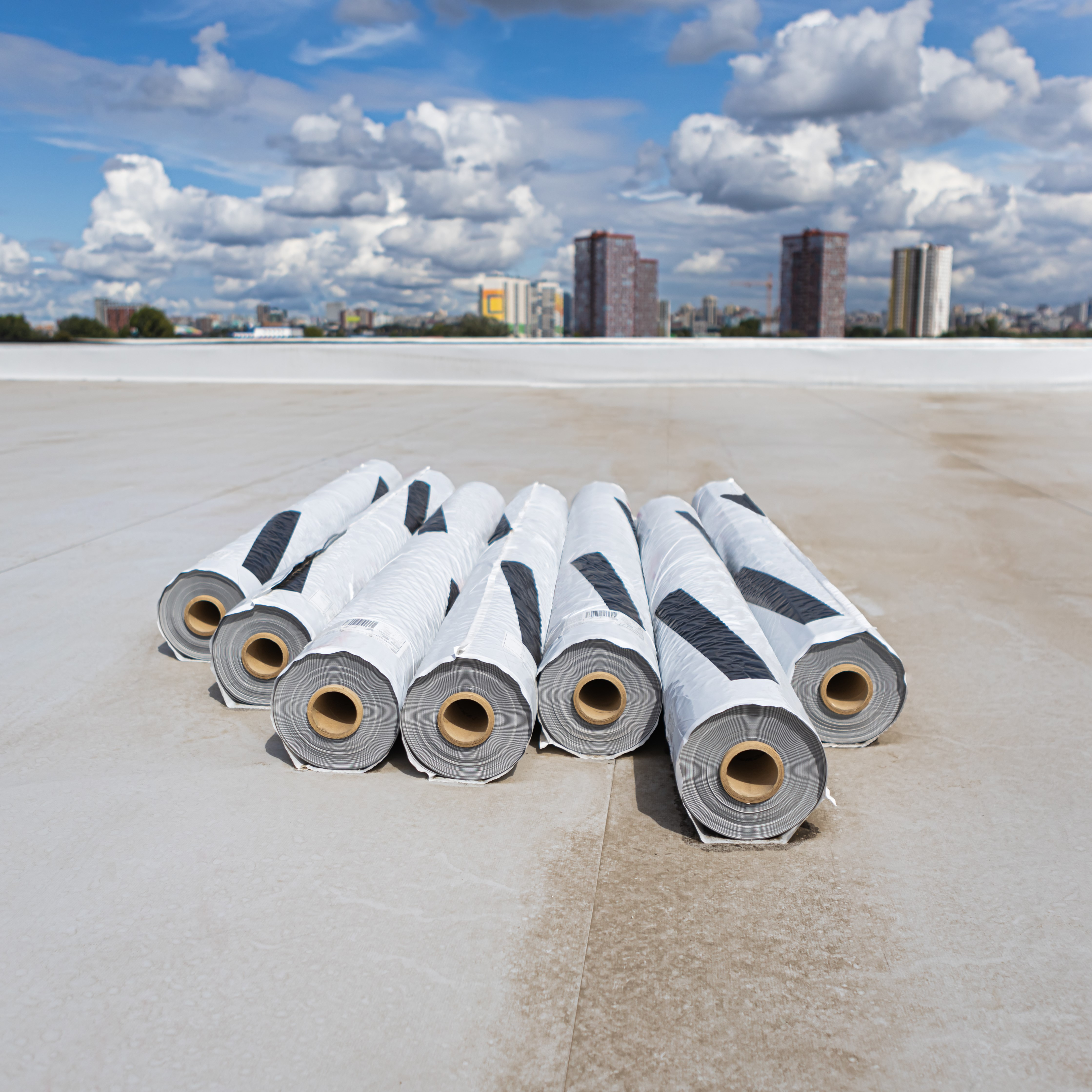Rolls of PVC membrane on top of a roof.