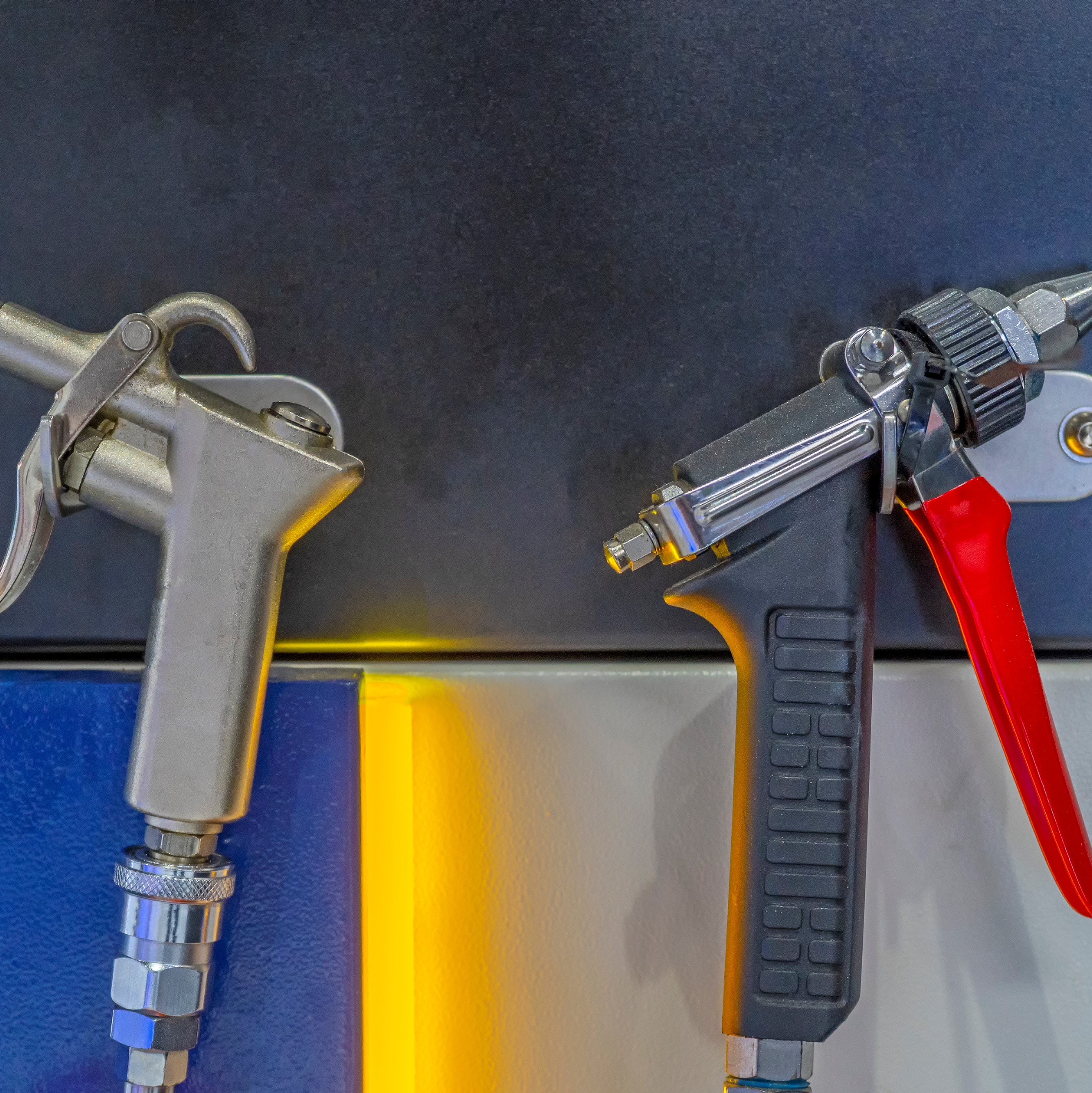 Air guns that are used to place coatings on roofs.