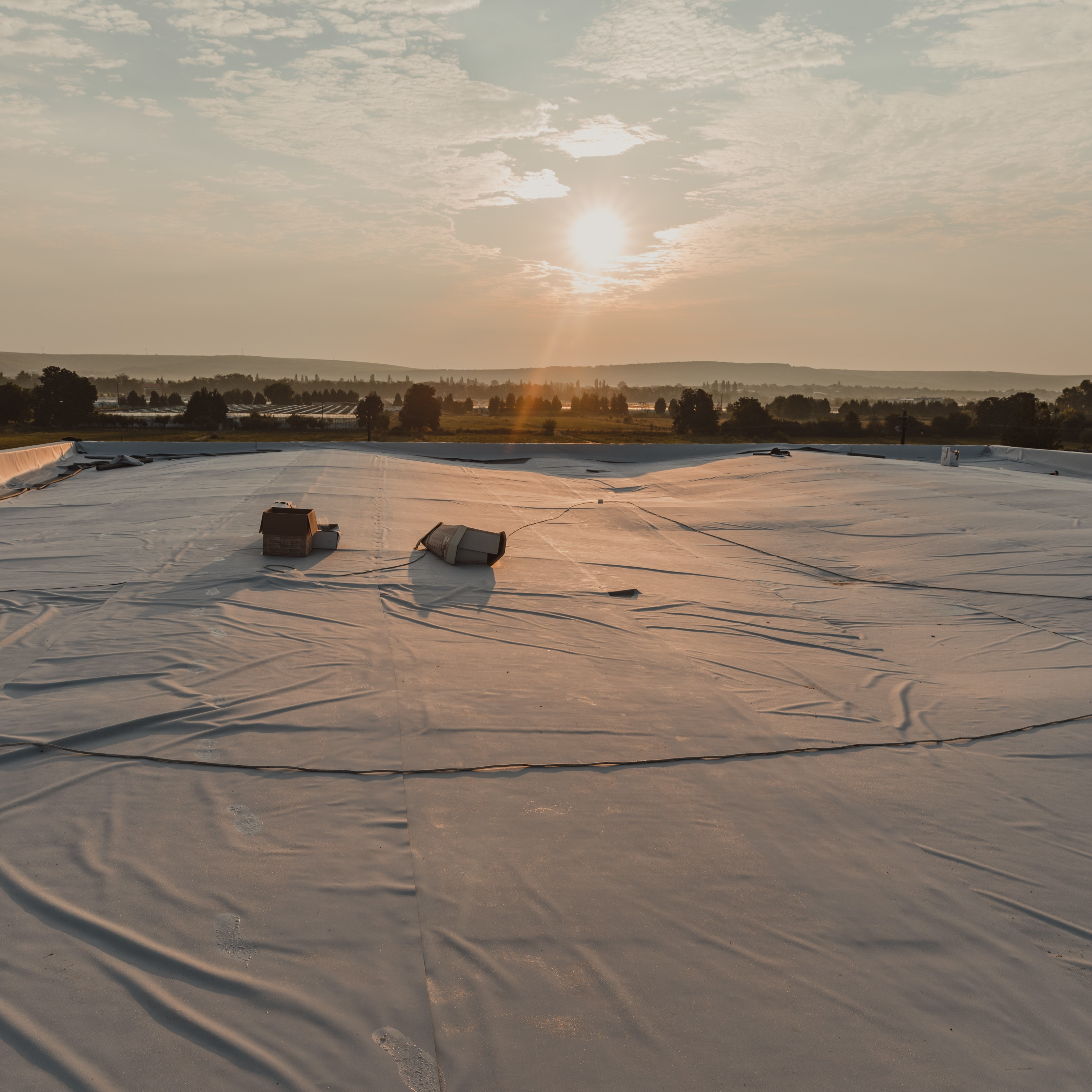 TPO membrane laid on top of a building during the installation process.