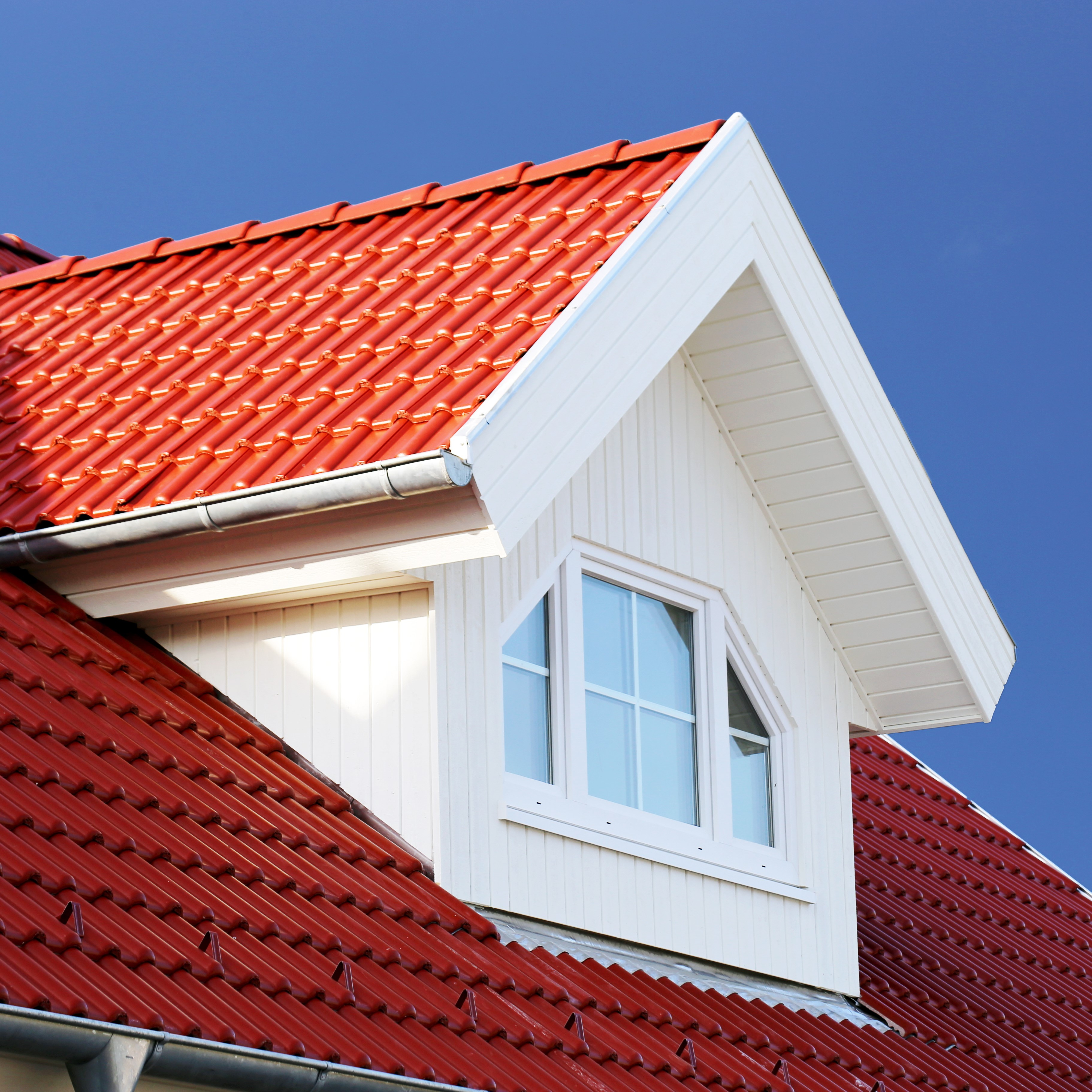 A red tile roof on a home.