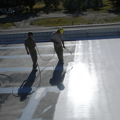 Contractors apply an acrylic coating.