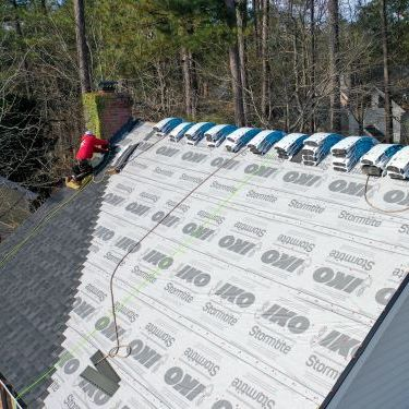 A Roofer Works to Repair a Roof.